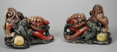 A pair of 19th century Chinese soapstone dog-of-fo groups Each with painted decoration.  Each 17