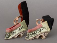 A pair early 20th century Chinese embroidered silk child's shoes With floral embroidery and