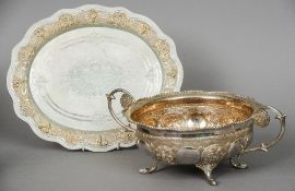 An Indian silver twin handled bowl Decorated with vignettes of flowers and Buddha; together with a