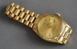 An 18 ct gold gentleman's vintage Rolex day date President wristwatch Fully stamped.  The dial 3.5