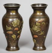 A pair of late 19th century Chinese patinated bronze vases Decorated with brass and copper floral