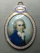 A George III portrait miniature of a gentleman Wearing  a blue coat, on ivory, the enamelled gold