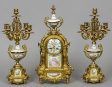 A 19th century Continental ormolu clock garniture Each piece decorated with  Sevres style painted