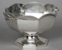 A silver rose bowl, hallmarked Birmingham 1929, maker's mark indistinct 14.5 cm high. CONDITION