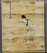 A Chinese embroidered silk panel Worked with a figure beside two Meiping vases, calligraphic
