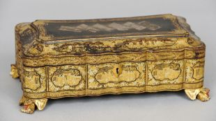 A late 19th century Chinese Export chinoiserie lacquered games box The shaped hinged rectangular top