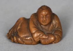 An early Chinese carved hardstone Buddha Modelled in recumbent position.  4.75 cm wide. CONDITION