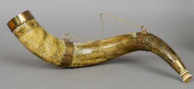 A large 19th century Scottish brass mounted scrimshawed hunting horn Decorated with stag hunting