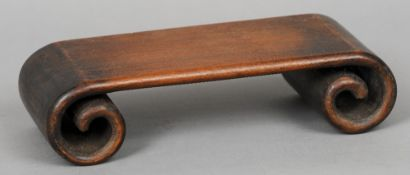 A Chinese carved hardwood scroll stand Of typical form.  31.5 cm wide. CONDITION REPORTS: