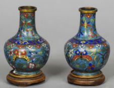 A pair of late 19th century Chinese cloisonne vases Each of squat baluster form, each standing on