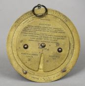 An early 20th century Negretti & Zambra brass barometer dial With three rotating panels with