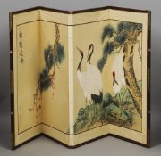 A Chinese low four fold screen Painted with cranes amongst trees and with calligraphy.  89 cm