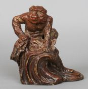 A late 19th/early 20th century painted metal model of a Japanese Macaque monkey With red and gilt