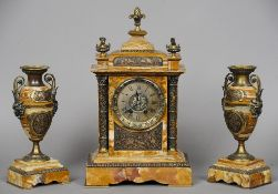 A patinated bronze mounted sienna marble clock garniture The clock with urn form finials above the