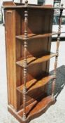A Victorian oak bookcase form dining table leaf holder One side with a panelled door with leaf