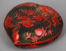 A large cinnabar lacquer box and cover Of heart form, decorated with peaches, the underside with six