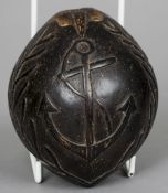 A 19th century carved coconut of maritime interest One side decorated with a flower between initials