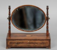 A 19th century inlaid mahogany dressing table mirror The oval bevelled plate supported by twin