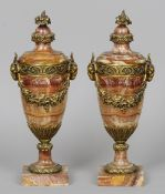 A pair of gilt mounted rouge marble vases Each with rams masks and floral swags.  Each 52 cm high.
