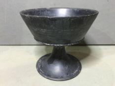 A Roman basalt pedestal bowl The exterior with triple line decoration.  15.5 cm diameter.