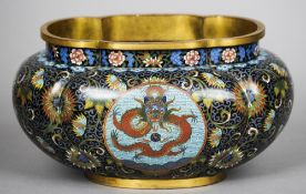 A late 19th century Chinese cloisonne bowl Of lobed form, with twin roundels decorated with a five