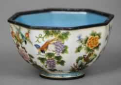 A Canton enamel octagonal bowl The exterior decorated with birds amongst foliage, the underside with
