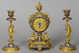 A 19th century champleve enamel decorated ormolu mantel clock garniture The circular dial with Roman