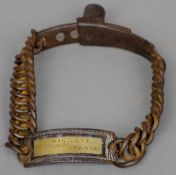 An early 19th century cast iron dog collar The identity tag engraved Wickett Chemist, Stratton.  11.