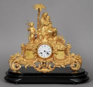 A 19th century gilt  metal mantel clock Surmounted with the Virgin and Child and a Baptist child,