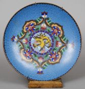 A Chinese cloisonne plate On a blue ground with floral scrollwork centred with a ho-ho bird.  25.