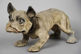 A 19th century papier mache growling French bulldog pull-toy Naturalistically modelled, wearing a