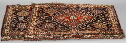 A pair of small Caucasian wool rugs Each with central stepped medallion interspersed with rosettes.