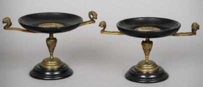 A pair of 19th century bronze and black slate tazza Each with twin mask handles, standing on a domed