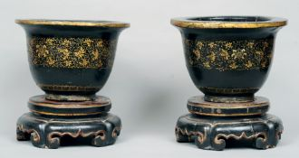 A pair of 19th century Eastern black lacquered jardinieres and stands Each of campana form with gilt