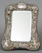 A Victorian pierced silver strut mirror, hallmarked London 1899, maker's mark of WC Decorated with