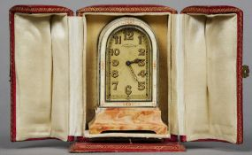 An enamel decorated miniature desk clock Mounted on a pink marble base, the dial inscribed The