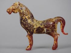 A Chinese amber glass model of a horse 7.5 cm high. CONDITION REPORTS: Generally in good