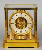 A LeCoultre brass cased Atmos clock Of typical form.  21 cm wide. CONDITION REPORTS: Some wear to