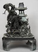 A 19th century Japanese bronze group Formed as Urashima Taro before the palace of Ryujin.  42 cm