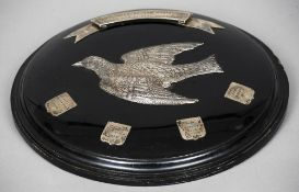 An early 20th century silver mounted sporting trophy plaque The ebonised roundel centred with a
