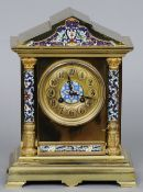 A 19th century French champleve enamel mounted brass mantel clock Of architectural form.  30.5 cm