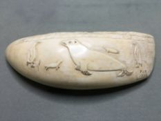 A mid 20th century carved sperm whale tooth