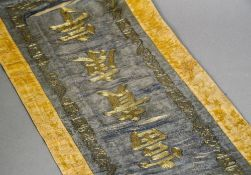A 19th century Chinese gold thread and silk rank badge Of typical form, with blue and yellow ground.