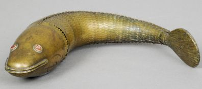 A Persian brass reticulated fish Typically modelled.  35 cm long. CONDITION REPORTS: One pin missing