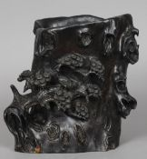 A Chinese carved zitan wood brush pot Naturalistically carved as a tree trunk,