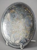 A 19th century silvered bidri ware plate Decorated with fish amongst foliage.  17 cm diameter.