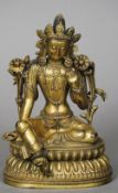 A Chinese gilt bronze figure of Buddha Typically modelled, seated in the lotus position. 23 cm high.
