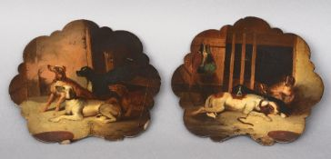 A pair of 19th century painted papier mache hand screen panels Each decorated with various