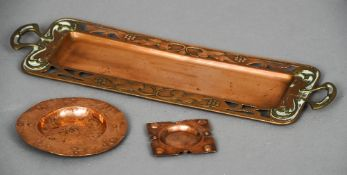 A WMF Art Nouveau copper twin handled tray Of rectangular form, the border pierced and with embossed