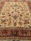 A Tabriz wool carpet The ivory field extensively filled with scrolling vines within stylised herati